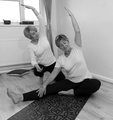Cardiff Yoga teacher Amanda Powell teaches a student one-to-one in her home studio