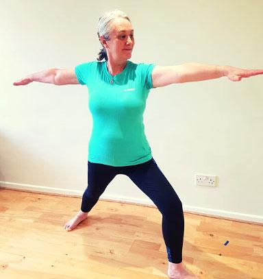 Cardiff Yoga teacher Amanda Powell (Anjali) demonstrates the yoga posture Warrior II or Veeriyasana 2