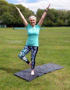 Yoga teacher Amanda Powell (Anjali) in an outdoor Yoga class at Creigiau, Cardiff